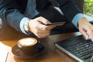 Businessman using credit card to buy online