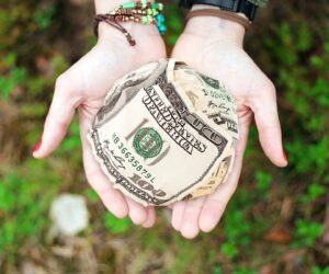 hands holding money ball for donations to a nonprofit