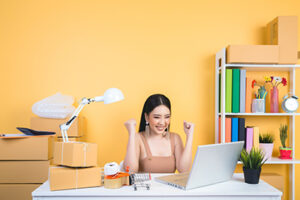 ecommerce business owner excited about her low credit card processing fees