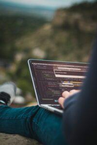 man programming on laptop