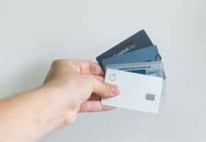 Person holding multiple credit and debit cards