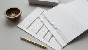financial paperwork on a desk with a pencil